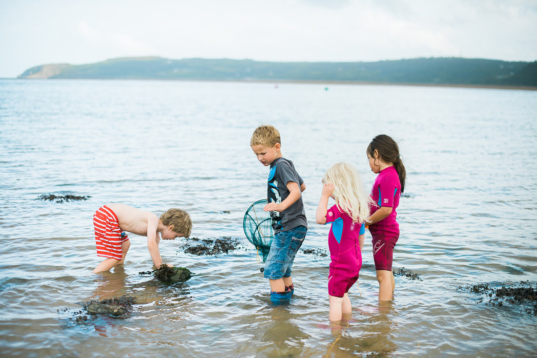 Kids on a beach, taken by Stockport Photographer