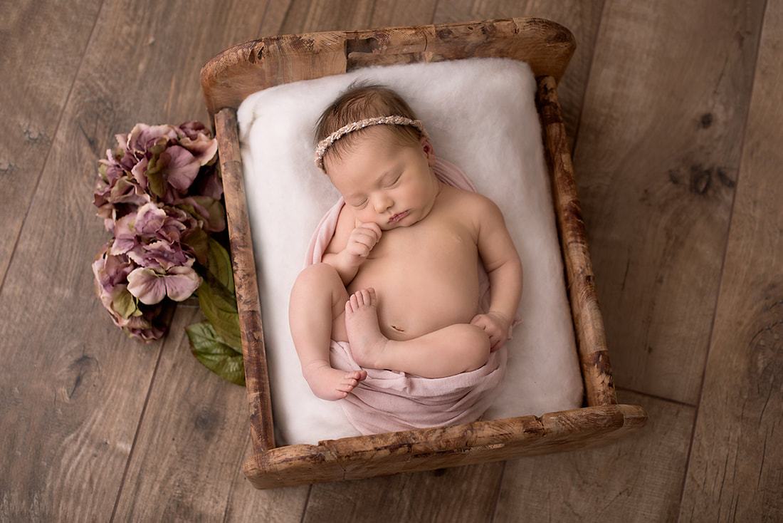 Baby girl taken by Stockport Photographer