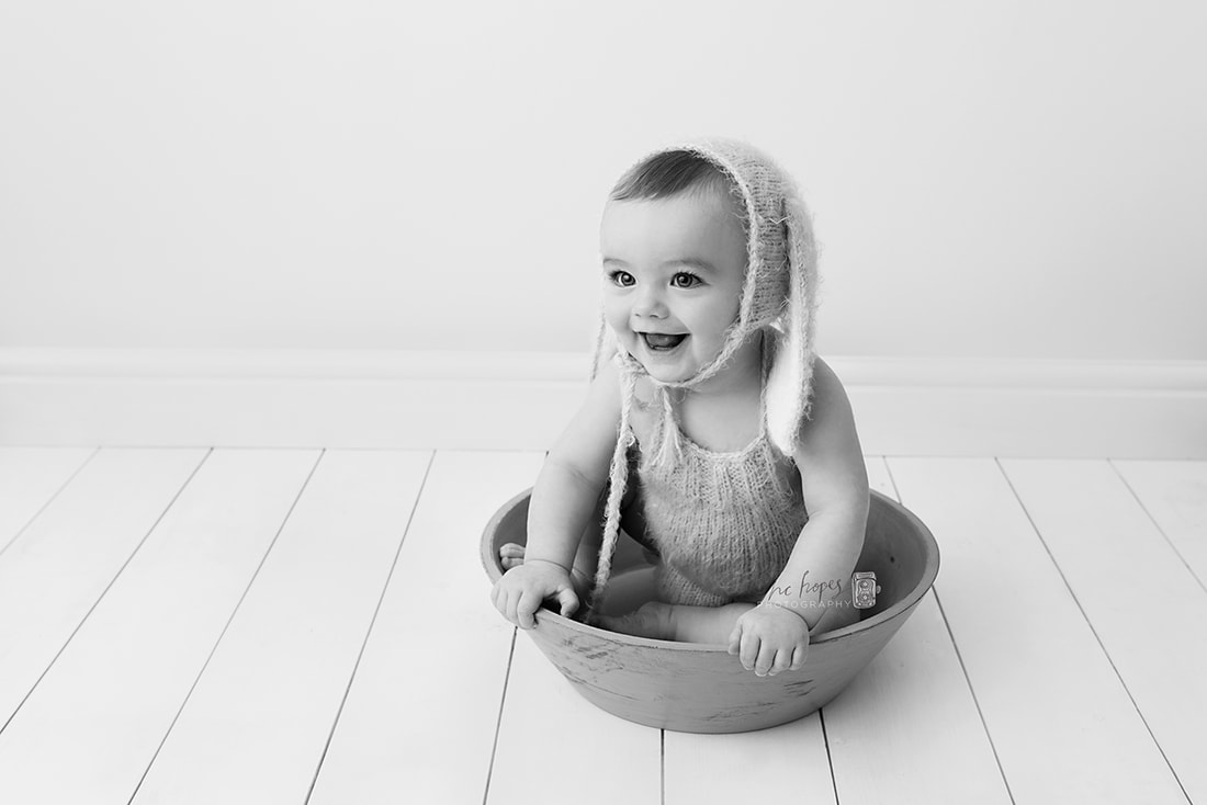 Black and white image of baby boy taken by Family Photographer Stockport