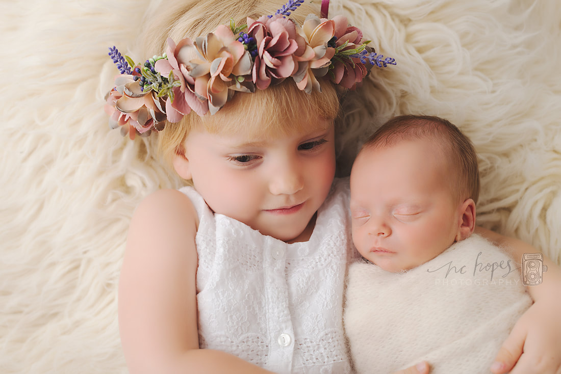 Can I bring brothers and sisters to my newborn photo shoot