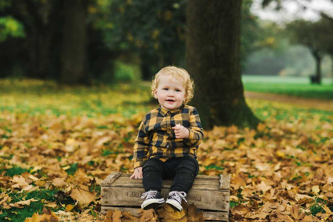 Photo of boy in Stockport Park in Autumn