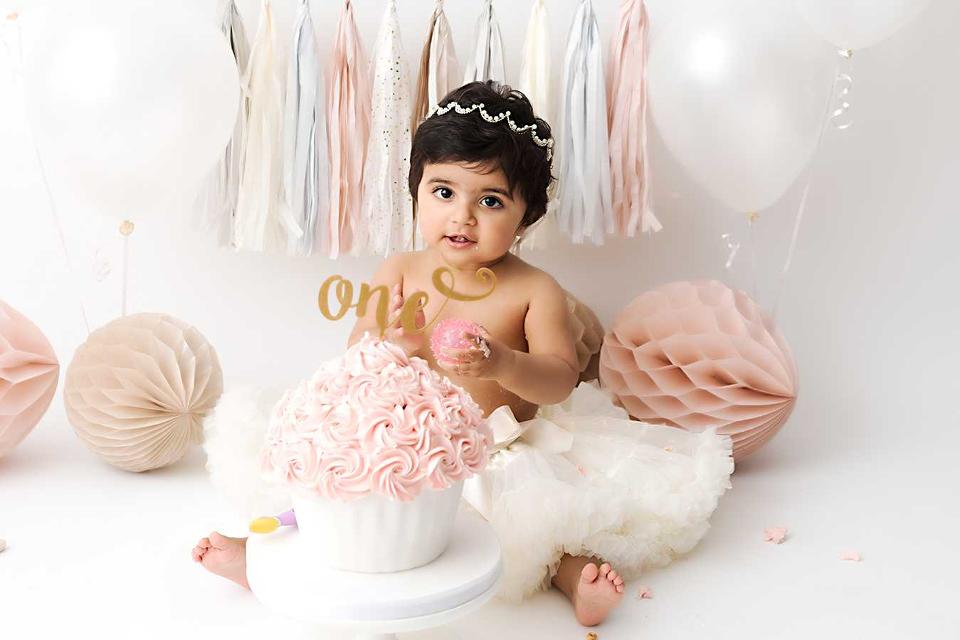 Photograph of baby girl during a Cake Smash Photoshoot in Cheadle Stockport