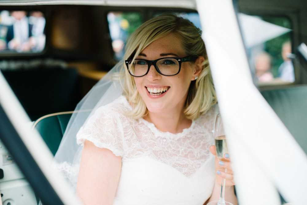 Bride waits in wedding car at Hilltop Barn in Poynton Stockport