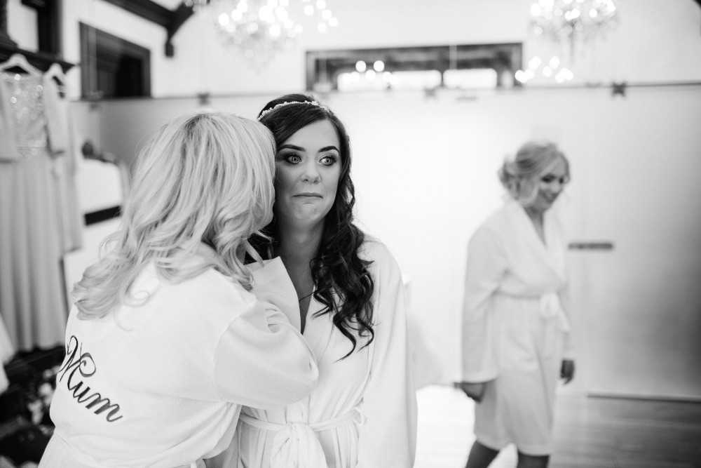 Bride pulling a nervous face on her wedding day at The Bridge Hotel Prestbury Cheshire