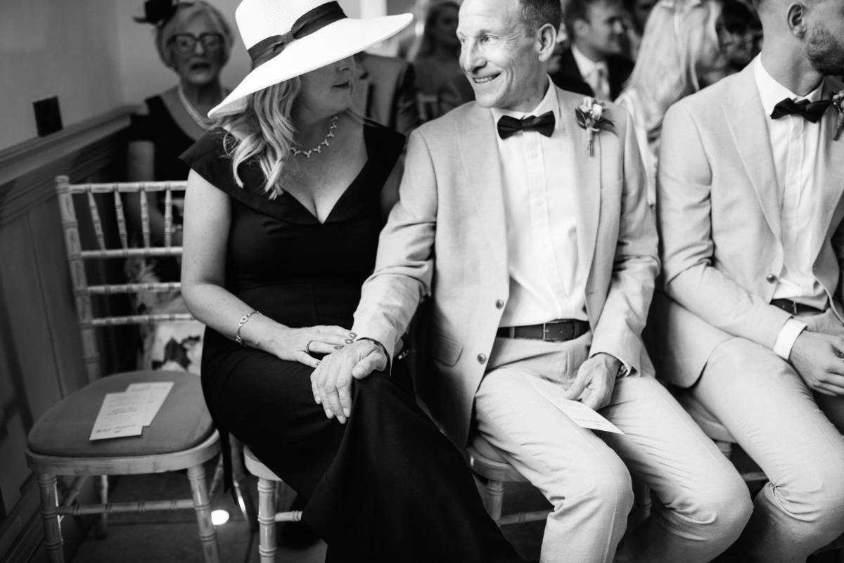 Wedding guests smile at Hilltop House Farm Wedding Prestbury