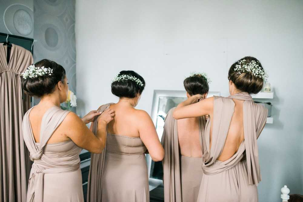 Bridesmaids getting ready in window lit room Manchester