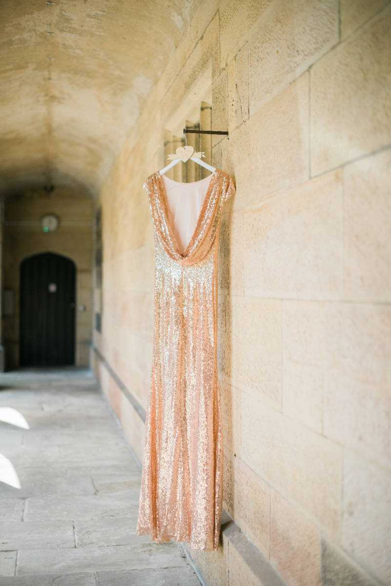 Sparkly rose gold Bridesmaid dress hanging up outside Great John's Street Hotel Manchester