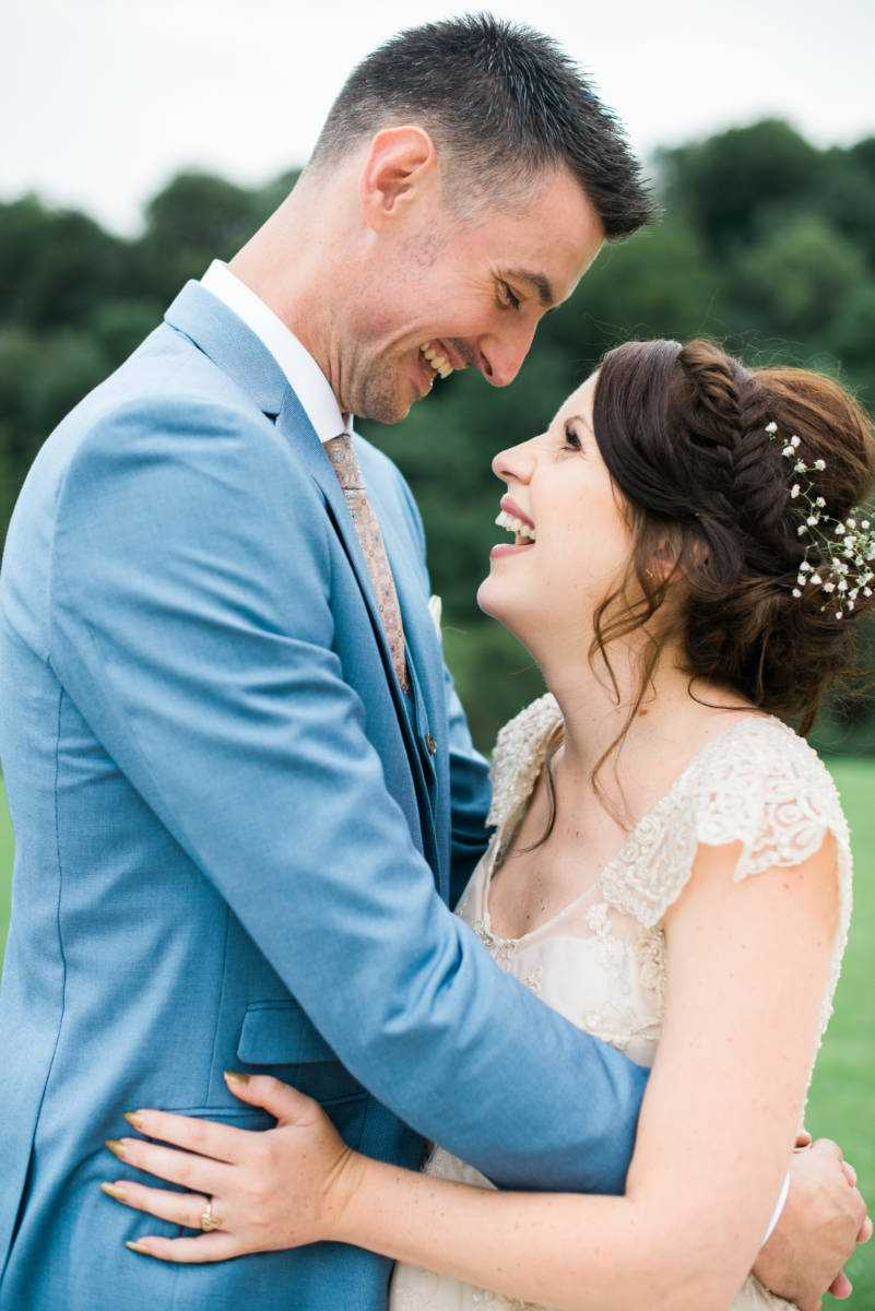 Bride and Groom laugh together at Deanwater Hotel Wedding