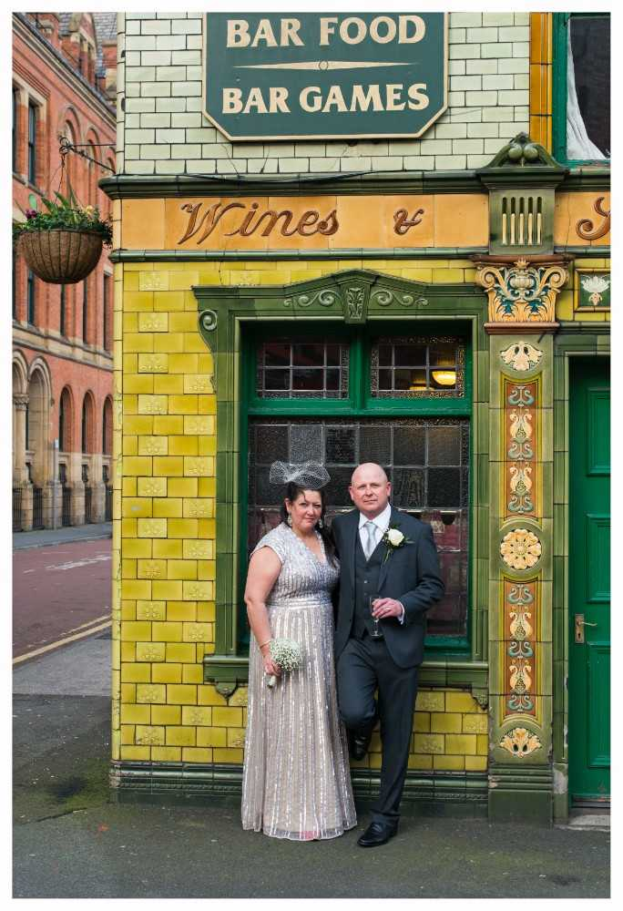 Wedding couple outside Peveril of the Peak pub in Manchester