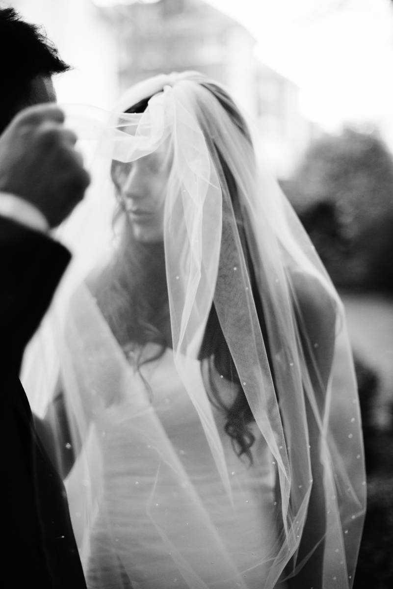 Groom lifts bridal veil at Didsbury House Hotel Wedding